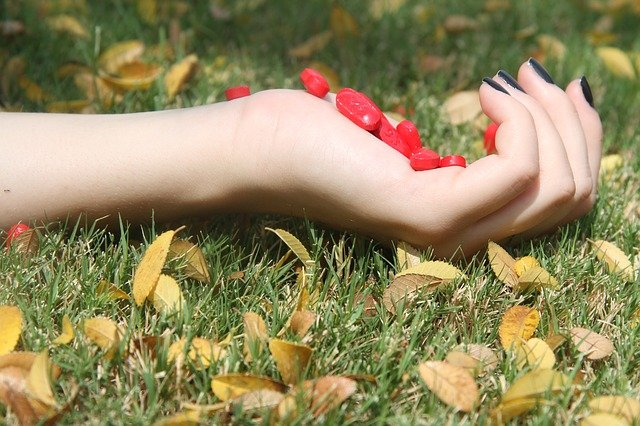 A person holding an object in the grass